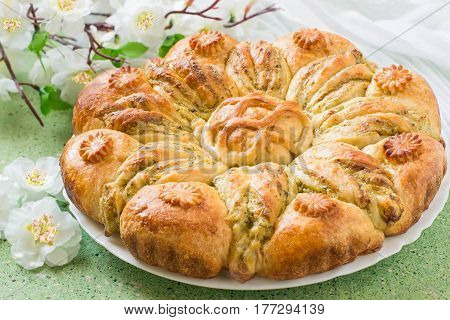 Creative homemade cake of yeast dough with stuffed of cottage cheese. The original cake in shape of flower and card for your text. Festive dessert for Mother's Day birthday anniversary