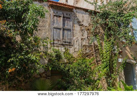 Rethymno, Greece - August  4, 2016:  Ancient Building And Trees.