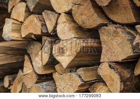 The palette of fresh lumber. Firewood for heating in agriculture.