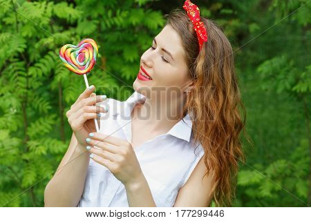 Girl With A Lollipop In The Trees In The Summer