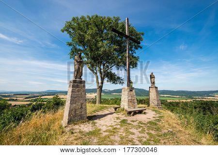 Cross on top of mount Brada in the Bohemia paradise