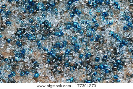 background of shiny colored and clear beads