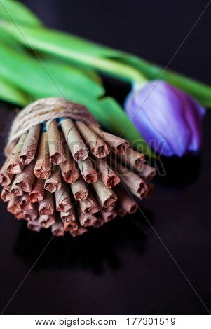 Natural Indian cigarettes bidi from the leaves of tobacco and herbs handmade with lilac tulip