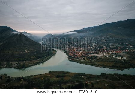 Aerial view of the old georgian capital town Mtskheta with confluence of the Aragvi and Kura at the morning. Landmark of landscape of Georgia