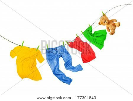 Laundry line with colored clothes isolated on a white background