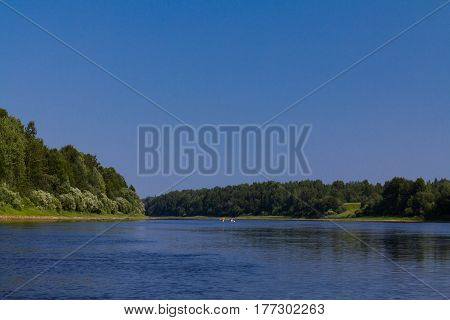 Catamaran on the river. Russian northen river