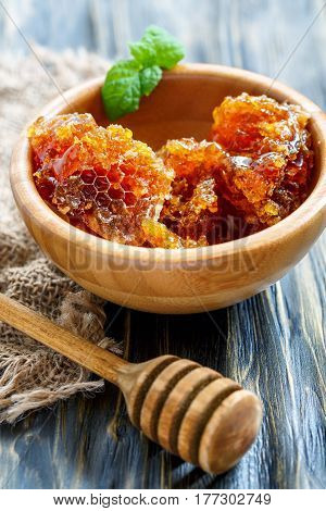 Wooden Bowl With Honey And Honey Dipper.