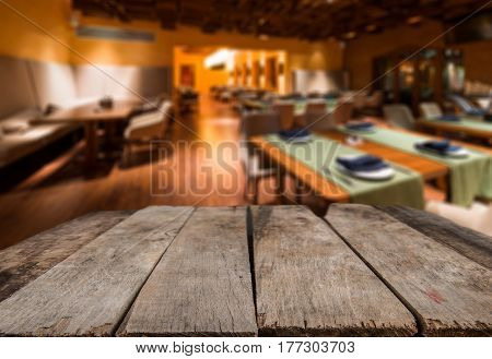 Empty Wooden Desk Space And Blurry Background Of Restaurant Vintage Tone For Product Display Montage