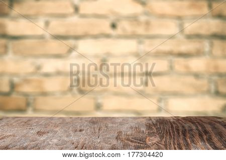 Empty Wooden Table Over Brick Background. Ready For Product Display Montage