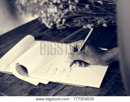 People Hand Writing Note in Flower Shop
