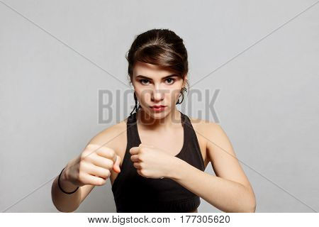 springhealth boxer sport people youth and beauty concept - Boxer woman ready for fights on dark gray background