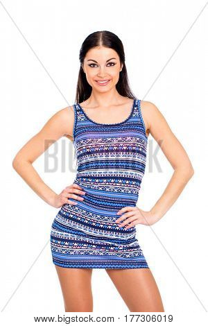 Beautiful brunette woman in blue dress, studio isolated on white background
