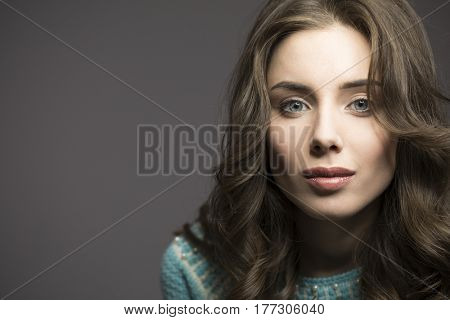 Studio portrait with ring flash effect. Stylish beautiful woman with day make-up and stylized wavy brunette hair