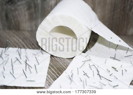 Toilet Paper With Nails In It.