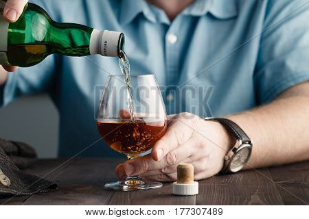 Addict Issue, Man Pours Himself A Whiskey