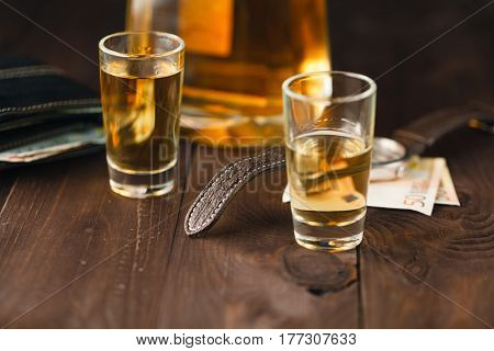 Weekend Drinks On Table, Glass With Brandy And Money On The Table