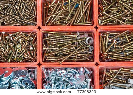 Close up picture of a stack steel nails construction supplies