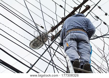 Picture of an electrician while working on an electric pylon