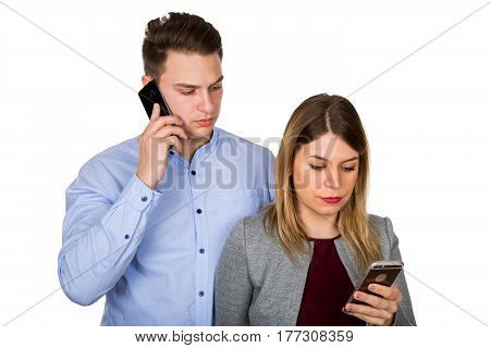 Picture of a young attractive couple being on their phones on isolated background