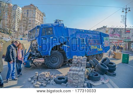 KIEV, UKRAINE - MARCH 22, 2014: People visiting destroyed police track at Khreshchatyk street near barricades.