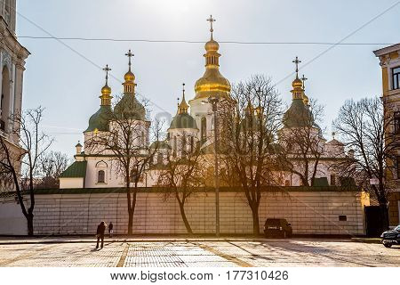 KIEV, UKRAINE - MARCH 22, 2014: People sightseeing Saint Sophia Cathedral at sunset at Sofiiska square.