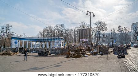 KIEV, UKRAINE - MARCH 22, 2014: People visiting barricades in front of entrance to the Dinamo Kiev Stadium witch still stands after Revolution in the center of the city.
