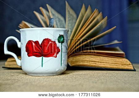 A cup of tea and an open book