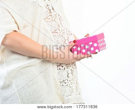 Female Hands Of Pregnant Woman Holding Pink Present Box