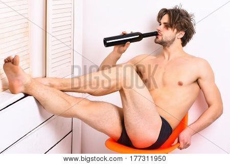 Caucasian Bearded Sexy Macho Holding Bottle