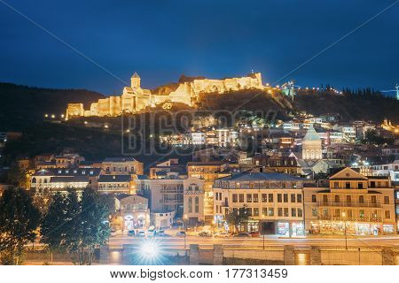 Tbilisi, Georgia - October 21, 2016: Narikala Ancient Fortress In Evening Night Illumination Under Blue Sky.