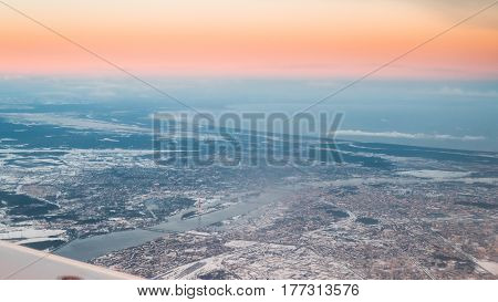 View From Airplane Window on Riga, Latvia. Sunset Sunrise Over Gulf Of Riga, Bay Of Riga, Or Gulf Of Livonia. Capital City