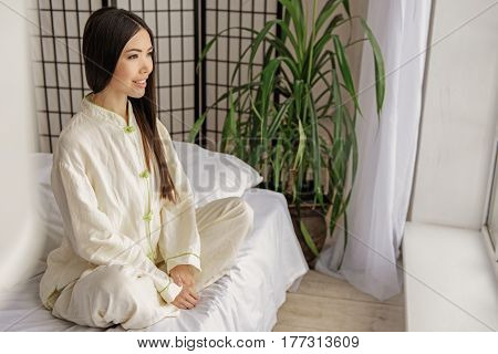 Side view of profile of asian woman expressing sense of well-being. Good feeling concept