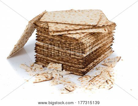 Pile of matza and some broken matza at the side - Traditional kosher bread for Passover