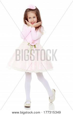 Dressy little girl long blonde hair, beautiful pink dress and a rose in her hair.She holds the palm of your hand near their cheeks.Isolated on white background.