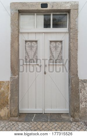 Old white wooden door with glass windows