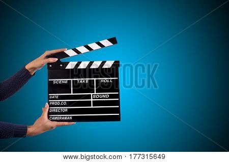 Clapperboard sign hold by female hands, close-up.