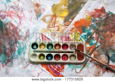 Children's abstract pattern and palette with brush.