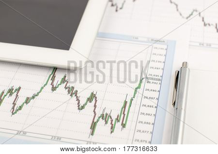 Tablet Computer, The Dow Jones Chart And Pen On A White Background, Business Concept.