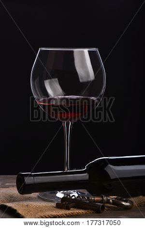 Wineglass With Bottle, Corkscrew On Wooden Table With Sackcloth Napkin