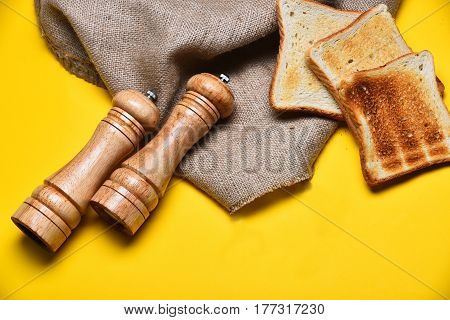 Fried Toast Bread, Saltcellar, Pepperbox And Burlap On Yellow Background