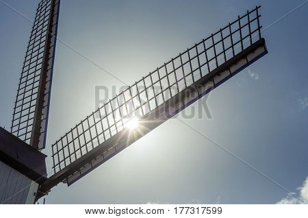 view on wing of windmill in sun backlight