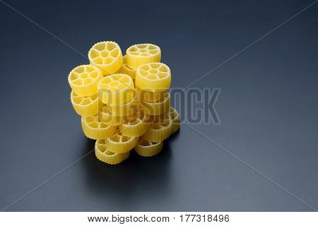 uncooked dry pasta in the shape of a wheel
