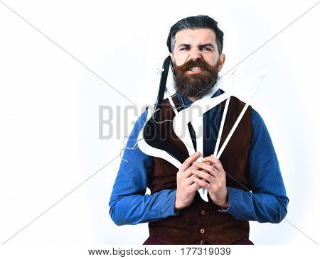 Bearded Man Holding Clothes Racks With Angry Face