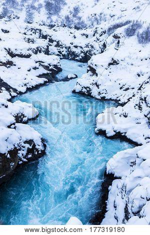 Beautiful Bruarfoss waterfall wit azure water in wintertime Iceland