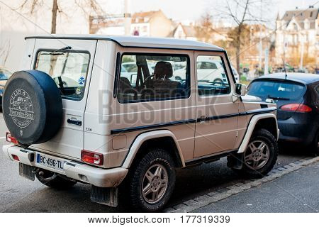 STRASBOURG FRANCE - FEB 13 2017: Rear view of white luxury white Mercedes-Benz G-Class suv parked on French street.