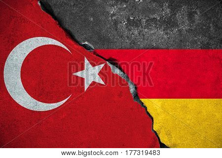 Germany Vs Turkey, Red Turkey Flag On Broken Damage Brick Wall And Half Germany Flag Background, Rel
