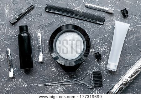 barbershop concept with hairdye tools on gray table background top view
