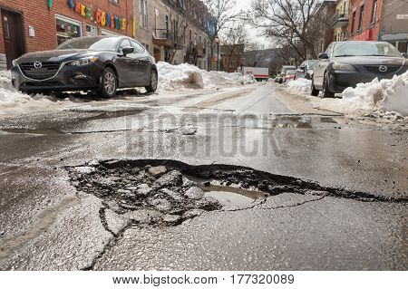 Montreal, Canada - 20 March 2017: Large Pothole On East Duluth Avenue.