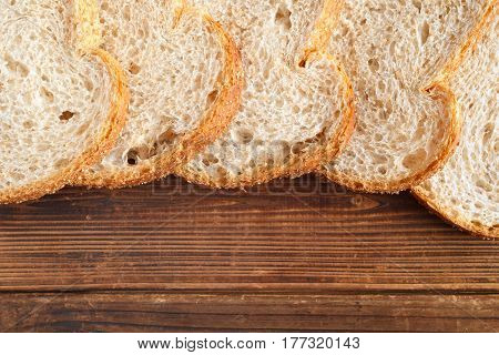 Bread slices on wood. Top down view.