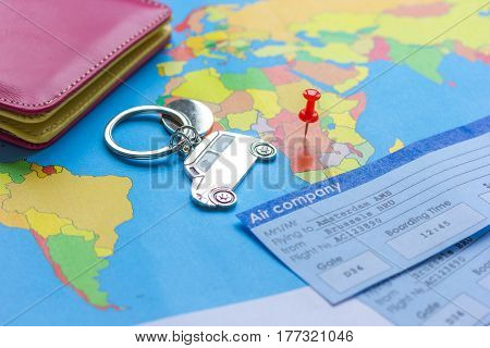 Preparation and booking travel concept with tickets and fob on map background